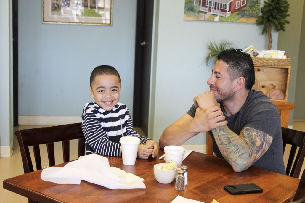 A happy father and son out for lunch at Rendezvous