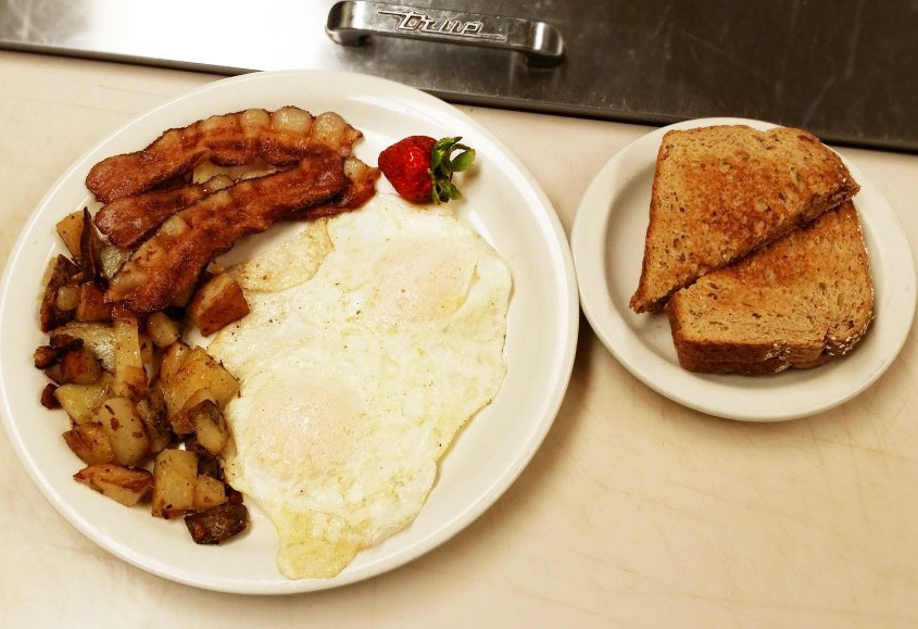 Bacon and egg breakfast with cottage fried potatoes