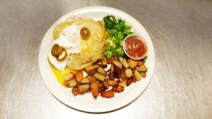 Huevos Rancheros with cottage fried potatoes and salsa