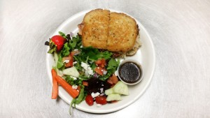 Reuben sandwich with house salad and homemade dressing